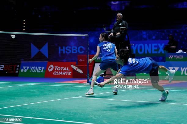 Japan's Yuta Watanabe leaps for a return as his partner Japan's Arisa Higashino covers the net against Japan's Yuki Kaneko and Japan's Misaki...