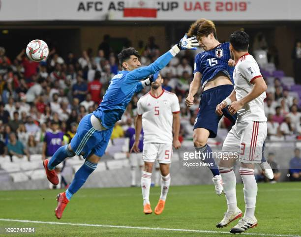 Japan's Yuya Osako heads home past Iran goalkeeper Alireza Beiranvand in the second half of an Asian Cup semifinal in Al Ain United Arab Emirates on...