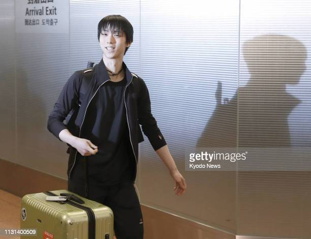 Japan's Yuzuru Hanyu arrives at Tokyo's Haneda airport on March 18 for the World Figure Skating Championships set to begin on March 20 in Saitama...