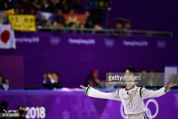 Japan's Yuzuru Hanyu celebrates winning the gold during the venue ceremony after the men's single skating free skating of the figure skating event...