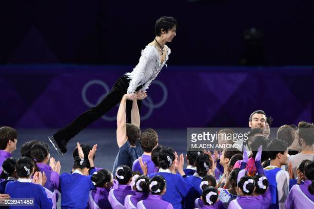 TOPSHOT Japan's Yuzuru Hanyu is lifted at the finale during the figure skating gala event during the Pyeongchang 2018 Winter Olympic Games at the...