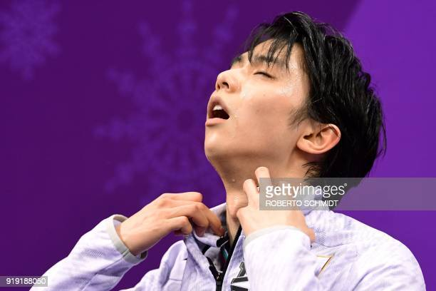 Japan's Yuzuru Hanyu reacts after competing in the men's single skating free skating of the figure skating event during the Pyeongchang 2018 Winter...