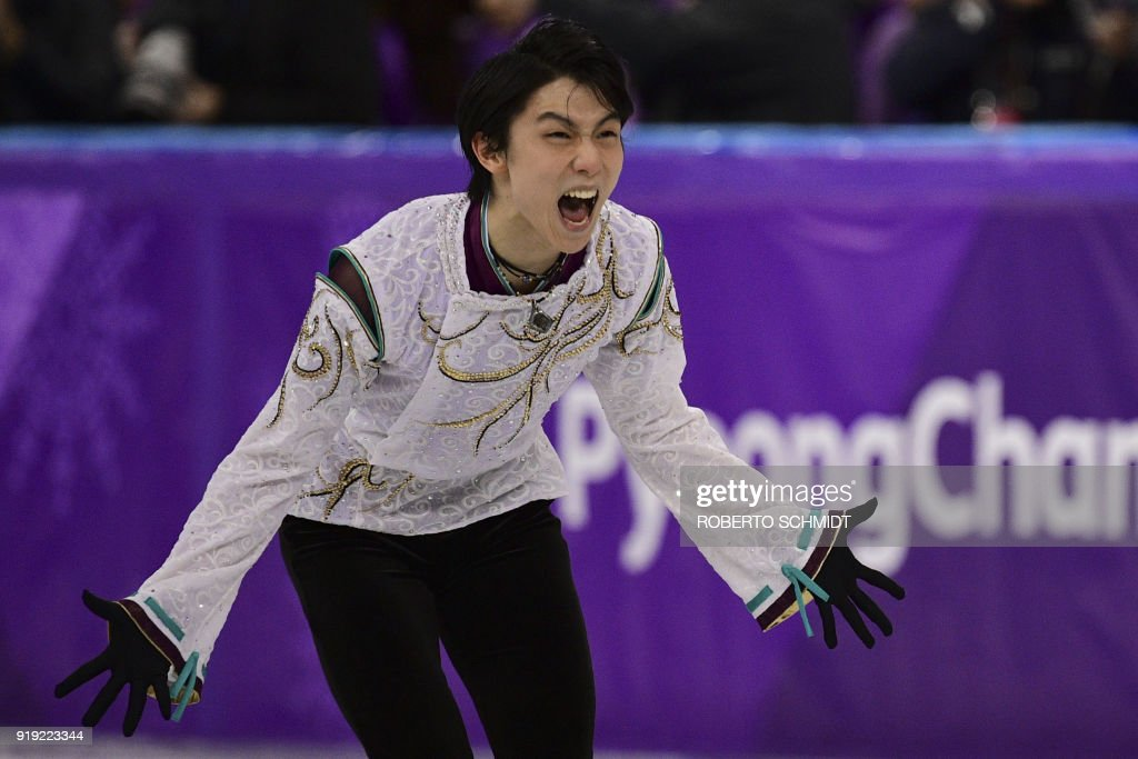 TOPSHOT - Japan's Yuzuru Hanyu reacts in the men's single skating free skating of the figure skating event during the Pyeongchang 2018 Winter Olympic Games at the Gangneung Ice Arena in Gangneung on February 17, 2018. / AFP PHOTO / Roberto SCHMIDT