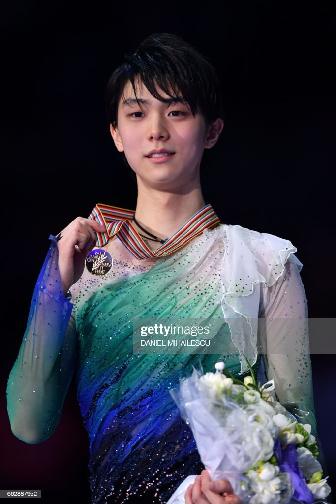 Japan's Yuzuru Hanyu reacts on the podium after winning the men's free skating program at the ISU World Figure Skating Championships 2017 in Helsinki on April 1, 2017. / AFP PHOTO / Daniel MIHAILESCU