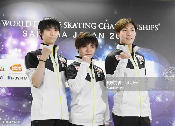 Japan's Yuzuru Hanyu Shoma Uno and Keiji Tanaka pose for a photo at a press conference in Saitama near Tokyo on March 19 a day before the start of...