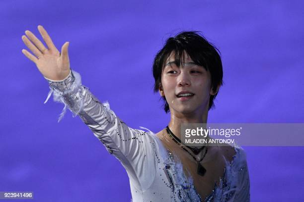 TOPSHOT Japan's Yuzuru Hanyu waves to the audience at the finale during the figure skating gala event during the Pyeongchang 2018 Winter Olympic...