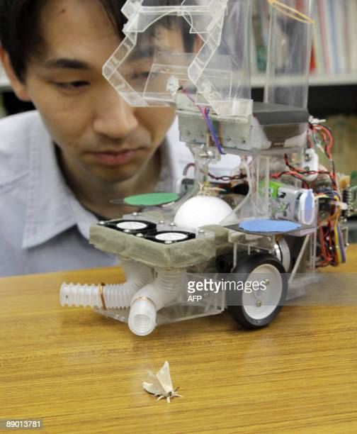 Japan-science-robot BY MIWA SUZUKI A picture taken on June 9 shows Japan's Tokyo University assistant professor Noriyasu Ando looking at a live male...