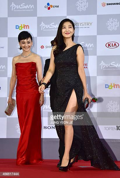 Japanses actress Kaho Minami and South Korean actress Lee EunHo of Kabuki Lovehotel walk on the red carpet for the opening ceremony of the 19th Busan...