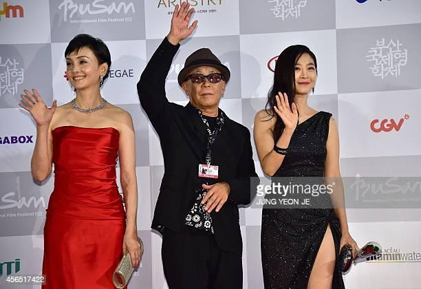 Japanses actress Kaho Minami director Ryuichi Hiroki and South Korean actress Lee EunHo of Kabuki Lovehotel pose on the red carpet for the opening...