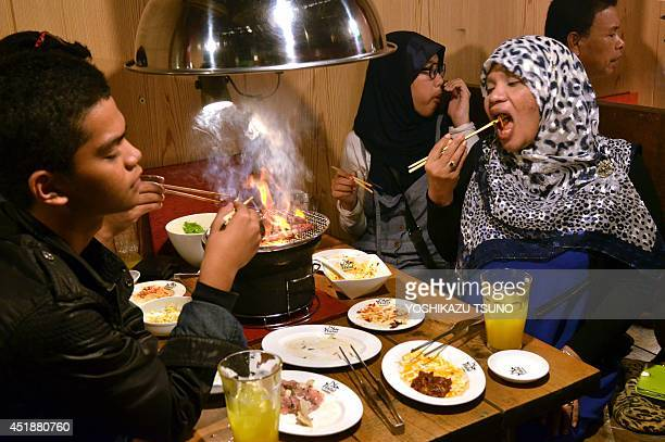 JapantourismreligionIslamFEATURE This picture taken on June 24 2014 shows Thai Muslim tourists enjoying Halal certified foods at a barbecue...