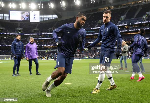 Japhet Tanganga and Giovani Lo Celso of Tottenham Hotspur warm up prior to the Premier League match between Tottenham Hotspur and Manchester City at...