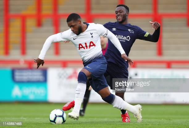 Japhet Tanganga of Tottenham battles for possession with Josh Shonibare of Derby County Hotspur during the Premier League 2 match between Tottenham...
