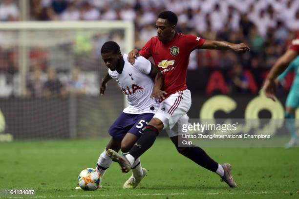 Japhet Tanganga of Tottenham Hotspur and Anthony Martial of Manchester United compete for the ball during the International Champions Cup match...