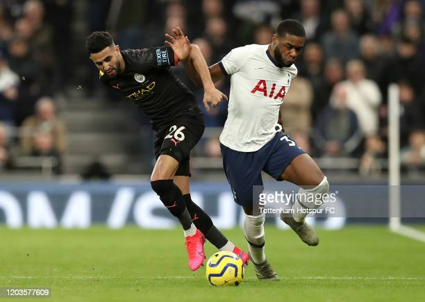 Japhet Tanganga of Tottenham Hotspur battles for possession with Riyad Mahrez of Manchester City during the Premier League match between Tottenham...