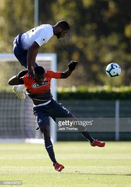 Japhet Tanganga of Tottenham Hotspur challenges for the ball with Botti Biabi of Swansea City during the Premier League 2 match between Tottenham...