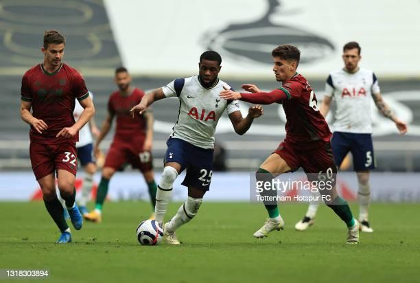 Japhet Tanganga of Tottenham Hotspur is challenged by Theo Corbeanu of Wolverhampton Wanderers during the Premier League match between Tottenham...