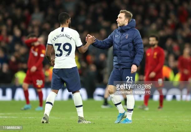 Japhet Tanganga of Tottenham Hotspur shakes hands with Christian Eriksen of Tottenham Hotspur after the Premier League match between Tottenham...