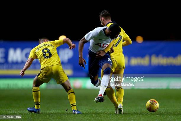 Japhet Tanganga of Tottenham Hotspur u21s is tackled by James Henry and Cameron Brannagan of Oxford United during the Checkatrade Trophy match...