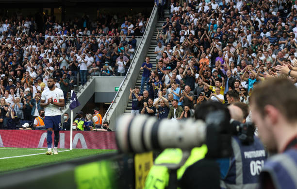 Japhet Tanganga of Tottenham is applauded by full crowds of fans as he leaves the pitch during the Premier League match between Tottenham Hotspur and...