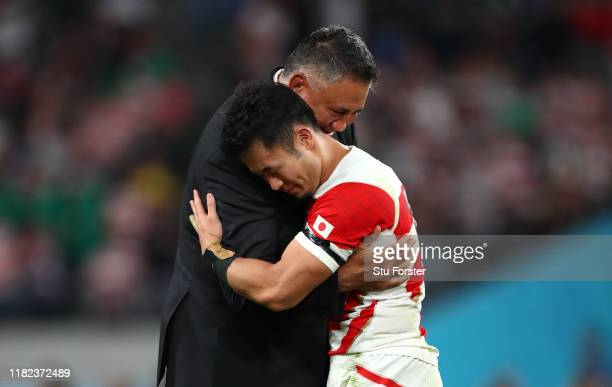 Japn head coach Jamie Joseph embraces Kenki Fukuoka after the Rugby World Cup 2019 Quarter Final match between Japan and South Africa at the Tokyo...