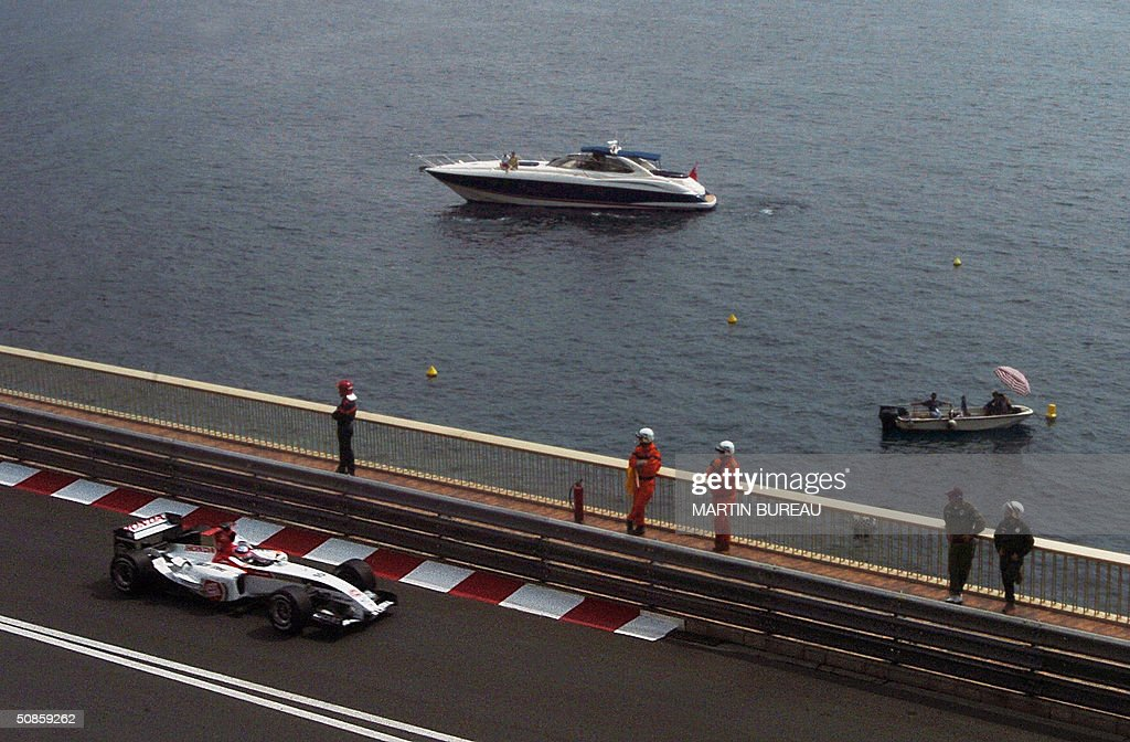 Japonese BAR-Honda driver Takuma Sato steers his car on the Monte-Carlo racetrack during the first free practice session three days before the Monaco Grand Prix, 20 May 2004 in Monaco.
