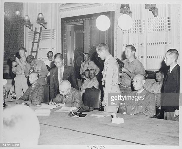 Japs Surrender in Korea Keijo Korea General Nobuyiki Abe Governor General of Korea signs the surrender documents in the throne room of the Governor's...