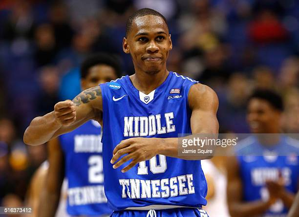Jaqawn Raymond of the Middle Tennessee Blue Raiders celebrates after a basket in the first half against the Michigan State Spartans during the first...