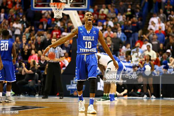 Jaqawn Raymond of the Middle Tennessee Blue Raiders celebrates late in the game against the Michigan State Spartans during the first round of the...