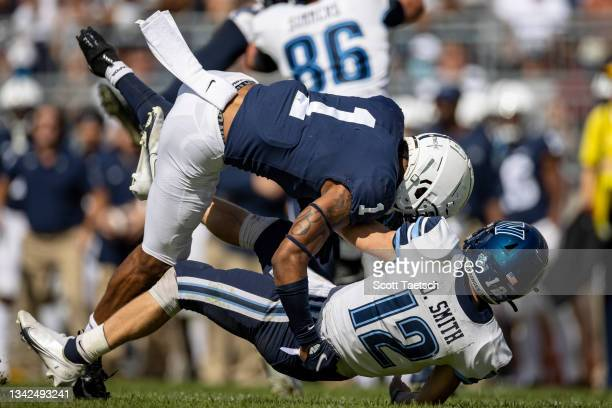 Jaquan Brisker of the Penn State Nittany Lions hits Daniel Smith of the Villanova Wildcats during the second half at Beaver Stadium on September 25,...