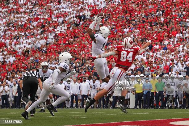 Jaquan Brisker of the Penn State Nittany Lions intercepts a pass intended for Jake Ferguson of the Wisconsin Badgers during the second half at Camp...