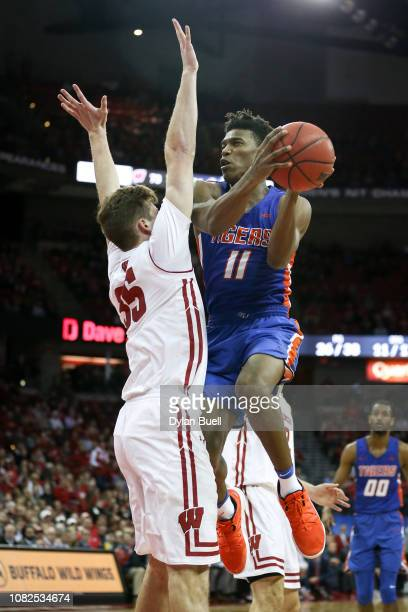 Jaquan Dotson of the Savannah State Tigers attempts a shot while being guarded by Nate Reuvers of the Wisconsin Badgers in the second half at the...