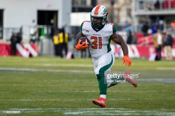 Ja'Quan Gardner of the Seattle Dragons carries the ball against the DC Defenders during the second half of the XFL game at Audi Field on February 8...