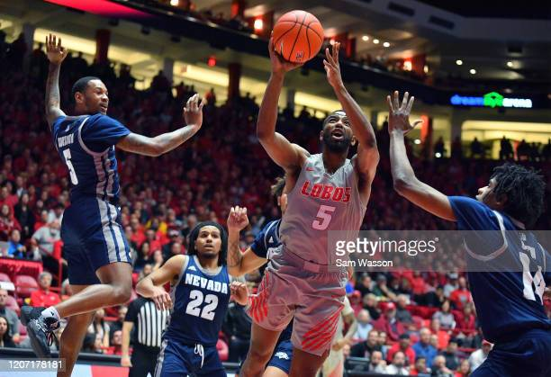 JaQuan Lyle of the New Mexico Lobos shoots against Nisre Zouzoua and Lindsey Drew of the Nevada Wolf Pack during their game at Dreamstyle Arena The...