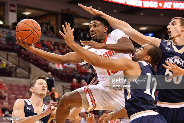 JaQuan Lyle of the Ohio State Buckeyes is fouled by Taylor Danaher of the Mount St Mary's Mountaineers as he drives to the basket in the first half...