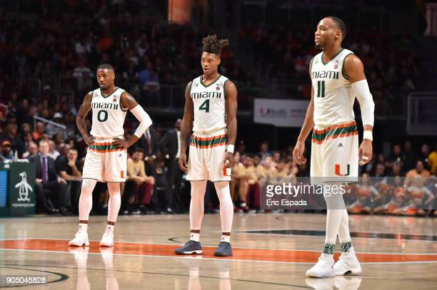 Ja'Quan Newton Lonnie Walker IV and Bruce Brown Jr #11 of the Miami Hurricanes stand at midcourt during the game against the Florida State Seminoles...