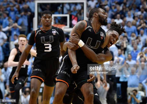 Ja'Quan Newton of the Miami Hurricanes celebrates with teammates after making the gamewinning basket against the North Carolina Tar Heels during...