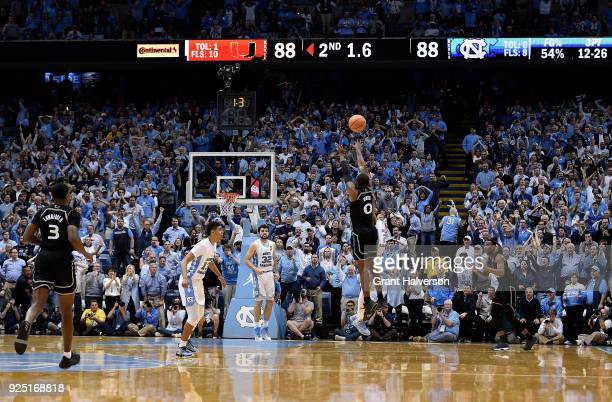 Ja'Quan Newton of the Miami Hurricanes makes the gamewinning basket as time expires during their game against the North Carolina Tar Heels at the...