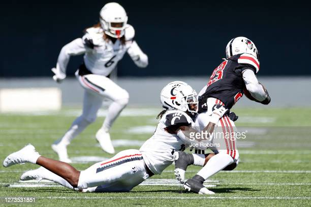 Jaquan Sheppard of the Cincinnati Bearcats makes a tackle against CJ Evans Jr. #23 of the Austin Peay Governors in the fourth quarter of the game at...
