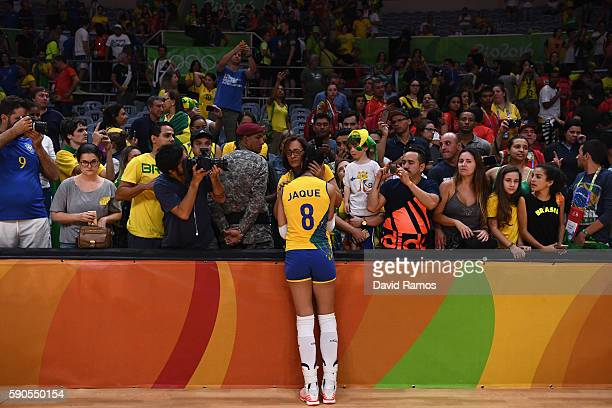 Jaqueline de Carvalho Endres of Brazil is comforted by fans after being defeated by China during the Women's Quarterfinal match between China and...