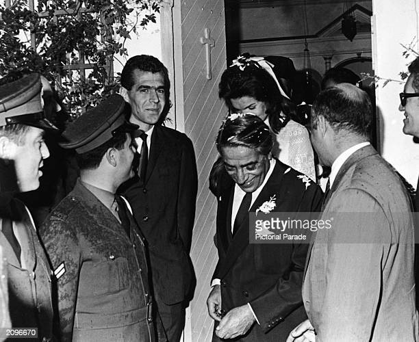 Jaqueline Kennedy Onassis and her new husband, Greek shipping magnate Aristotle Onassis leave the chapel shortly after their wedding ceremony on the...