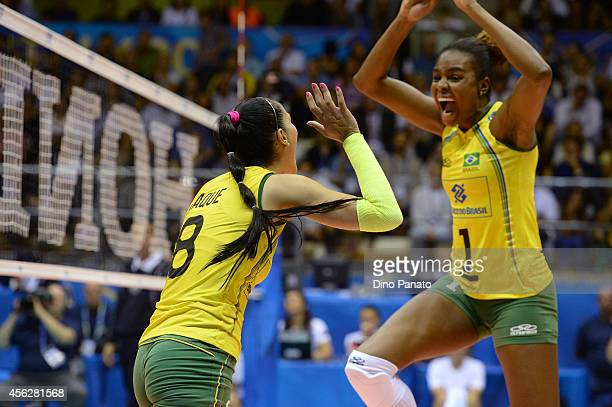 Jaqueline Pereira De Carvalho Endres and Fabiana Claudino of Brazil celebrate victory after the FIVB Women's World Championship pool Brankica...