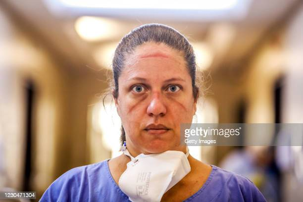 Jaqueline Portal Lopes nurse technician poses for a photo without her face mask at the Intensive Care Unit of the Santa Casa de Misericordia Hospital...