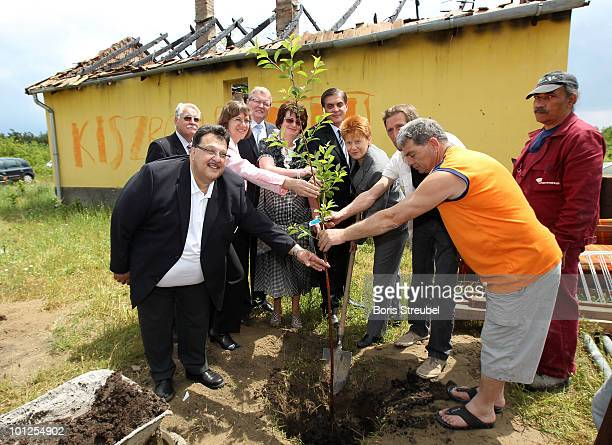Jaques Delfeld of the Central Council of Romani people in Germany Walter Desch president of the rhineland football association Dorothee...