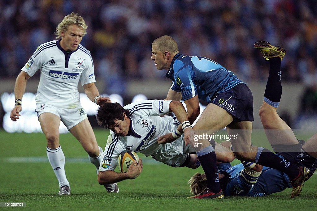 Jaques Fourie(L) of the Stormers is tackled by Jaco Pretorius(R) of the Bulls on May 29, 2010 during the Super14 Final match between Bulls and Stormers at Soweto's Orlando stadium in Johannesburg, South Africa.