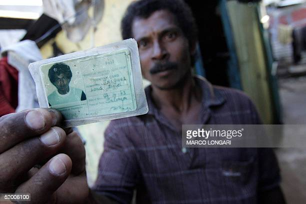 Jaques Louis Arniel shows 17 January 2005 in Port Louis Mauritius his identity card stating his birth place as the Solomon Island Chagos Arniel like...