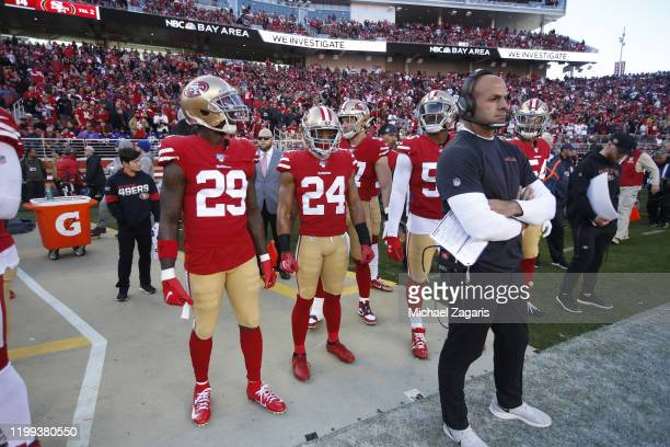 Jaquiski Tartt K'Waun Williams and Defensive Coordinator Robert Saleh of the San Francisco 49ers stand on the sideline during the game against the...