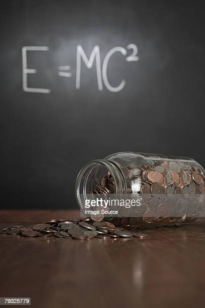 Jar and money in classroom