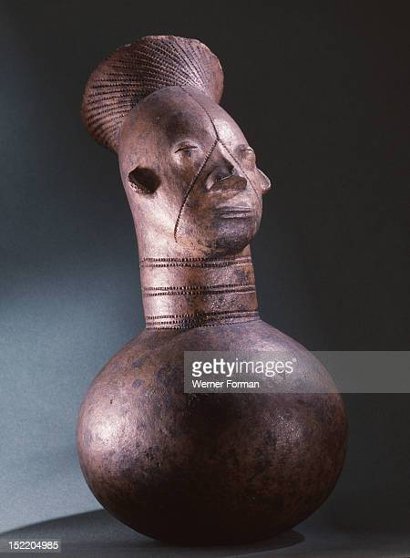 Jar depicting the womens headdress and the lengthened skull achieved by binding the heads of babies among the Mangbetu Democratic Republic of Congo...