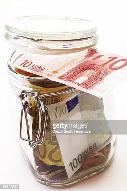 Jar filled with euro bank notes