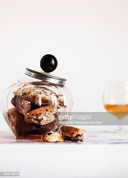 Jar of biscotti on table